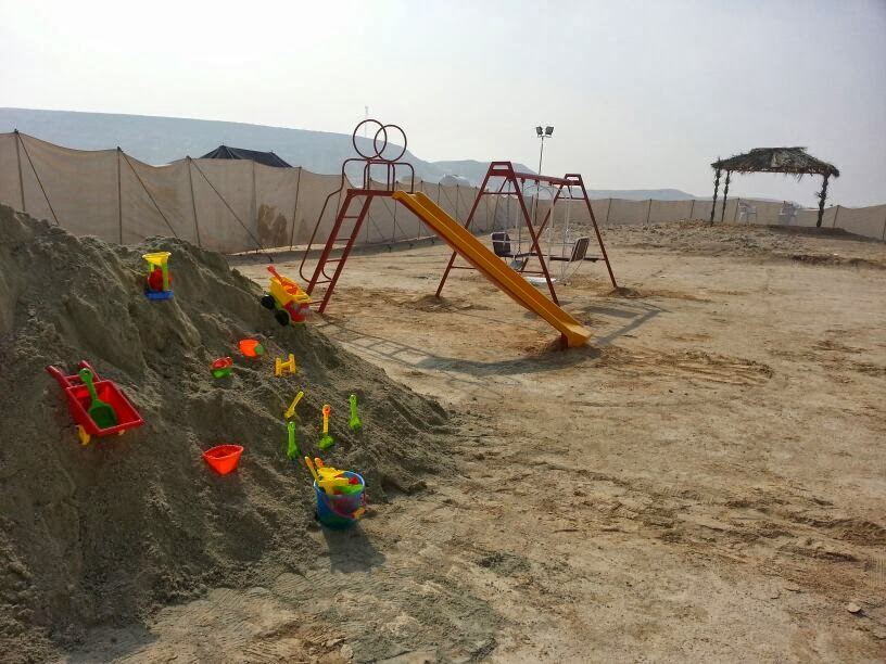 Children's sandpit, slide and swings