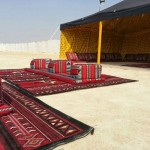 Outside seating area and open tent in Wady Al A'amer